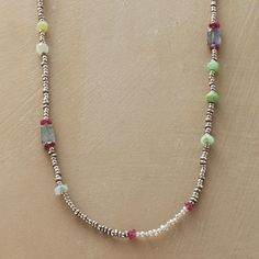 """HIGHLIGHTS NECKLACE--A plethora of gems that include labradorite, chrysoprase, cultured pearl, aquamarine, ruby and sterling silver beads punctuates our super long handmade bead and gemstone necklace of silvery seed beads. Button and loop closure. Exclusive. Handmade in USA. 32""""L."""