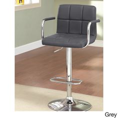With a tufted design, this modern bar stool has a wide variety of color choices that could brighten any room. A comfortable leatherette padding and metal armrest bring durability and comfort to this distinct bar stool.