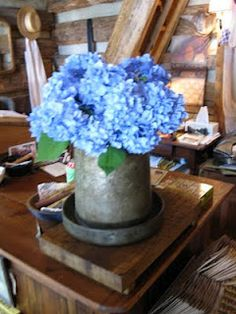 I have one of these old chicken feeders but never thought to put flowers in it! Love it!
