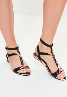 Get all studded with these black flat sandals with rose gold stud details.