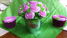 Cupcake bouquets - mini chocolate cupcakes with vanilla buttercream piped like roses with jumbo cupcakes to match.