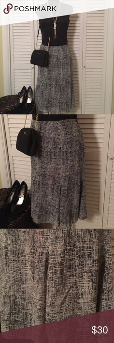 """Black, grays,  and White Flare Skirt Beautiful Skirt that's flared so gorgeous at the tail.  An almost gauzy style print.  Zips and hooks in Back.  Waist is 30"""" there's no stretch. More of an A-Line Skirt with a flare at bottom.  Length is  25"""".  This Skirt is in Excellent Condition.  Shoes and Bag in 1st photo are also for sale in my closet in other listings. Joneswear Skirts A-Line or Full"""
