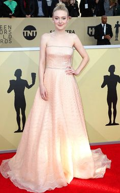 Dakota Fanning from Standout Style Moments at SAG Awards 2018  The actress looked like a modern-day princess in a strapless, peachy-nude gown.