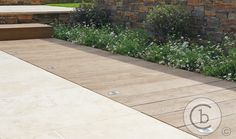Contemporary family garden in kent - limestone paving with millboard eco decking   Ben Chandler Landscape & Garden Design