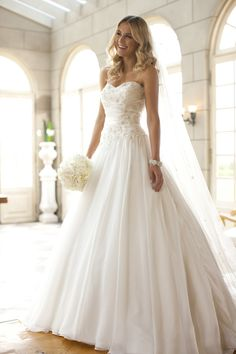 Stella York...AHHHHH love this style of dress! Just wish there were sleeves and lace!
