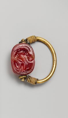 Carnelian scarab Period: Late Classical. Date: early 4th century B.C. Culture: Etruscan. Medium: Carnelian, gold.