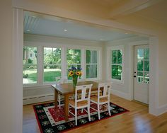 Breakfast room addition with custom millwork, beadboard ceiling and cottage style windows