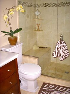 Limestone shower with seat - vanities with drawers make so much sense.