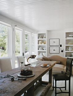 Eclectic-Scandanavian; white painted wood; farm table, camelback settee