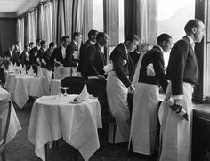 Waiters in the Grand Hotel Dining Room watching Sonja Henie ice skating. St. Moritz 1932 – Alfred Eisenstaedt.