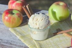 Scoopsies' Apple Cinnamon Ice Cream: (yields 1 quart) 6 apples, peeled and chopped, divided 1 tbl maple syrup 1 tbl butter 2 tbl ground cinnamon, divided 1 1/2 cups heavy cream 1 1/2 cups milk 1/2 cup packed brown sugar 1/4 tsp cloves 4 egg yolks