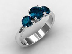 London blue topaz trinity engagement ring made from white gold  by TorkkeliJewellery, $1670.00