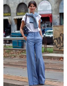 milan street style - loving the retro vibe.  high waisted, wide leg denim + boyfriend slouchy T