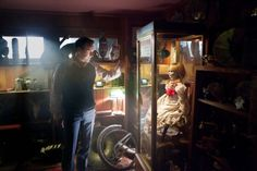 Ed Warren (Patrick Wilson) with Annabelle the cursed doll in the Warren's Occult Museum, from The Conjuring 2013