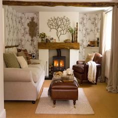 Like this simple fireplace with wood burning stove, also like the use of wallpaper