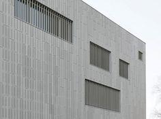 Smooth concrete cladding