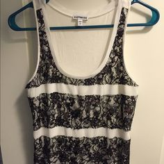 Business Casual Tank White tank with black lace design on the front of the top. Bare white back with no design. Express Tops Tank Tops