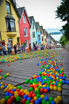 The Barrack Hill Ball Roll is a unique lottery when thousands of coloured numbered balls cascade and bounce down West View in Cobh, Ireland. (by KerryJordanTog)