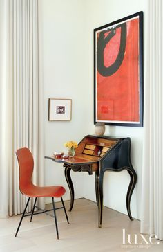 Contemporary Chicago Penthouse With Vintage Antiques: A vintage 1960s chair pulls up to the living room's Napoleon III style secretaire, both from The Golden Triangle.