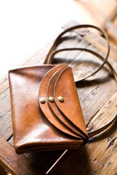 love this hand-stitched leather purse.  each flap opens to a different compartment!