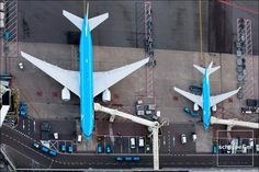 A Boeing 737 and 777 from KLM.  They look similar, but their scale is vastly different