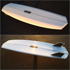 "This is a RAD concept twin fin. 5'5"" x 20"" x 2 5/16"" 32.6L by @vulcansurf with red density poly"