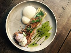 Greena and white asparagus with poached egg,pancetta crumbs and sauce Béarnaise.