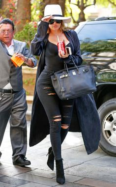 Khloé Kardashian from The Big Picture: Today's Hot Pics The Kocktails with Khloé star is seen rocking black ripped jeans as she heads into the Four Seasons hotel in Beverly Hills.