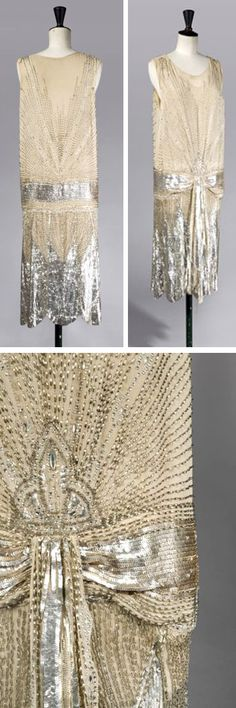Evening dress, possibly Poiret, ca. 1920. Beige chiffon embroidered with beads, sequins, and gold and silver rhinestones, accentuated by a low waist belt effect enhanced by two floating panels on the front. Artcurial