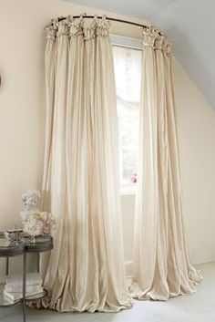 Use a curved shower curtain rod to make a window look bigger. Balloon drapery and it will make any living room look just GRAND. Balloon Drapery Panel from Soft Surroundings