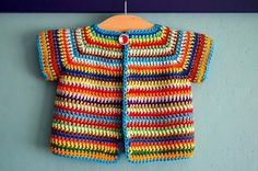 FREE crochet pattern for a cute baby cardigan.A great way to learn about basic…