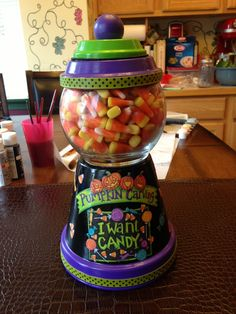 I just made this Terra Cotta candy jar! How fun!