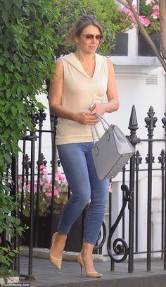 Still glamorous: Despite the casual nature of her outfit - skinny jeans and a hooded top -...