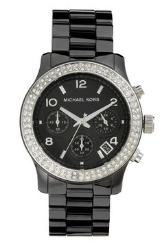 You're looking sharp and punctual with this bold Runway Ceramic Watch by Michael Kors.  We love it in black but they also have it in white which is a fresh and fun alternative.