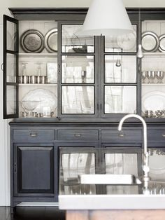 Beautiful black cabinet accessorized with sterling chinaware