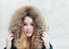 Winter portrait of beautiful girl in fur close-up. Toned in warm colors. - Winter portrait of beautiful girl close-up