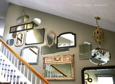 Hang Vintage Mirrors On The Stairway To Create A Lovely Look...old mirrors with character...love that some of them overlap.  A junk tour of Bella Rustica Linda's house via Funky Junk Interiors - mirror wall.