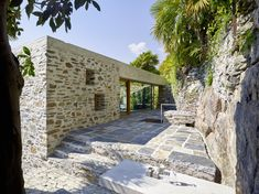 Wespi de Meuron Romeo architect has renovated a single family house on the Lake Maggiore, featuring big windows that integrate the interior into the garden and create a unity with the existing stonewalls.