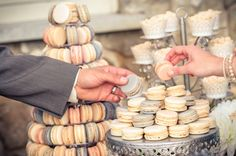 Macaroons with escort card table. Take a treat & pick a seat