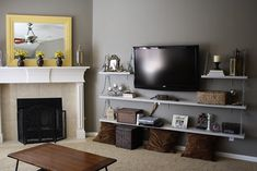 like the look of the shelves around tv mounted on wall