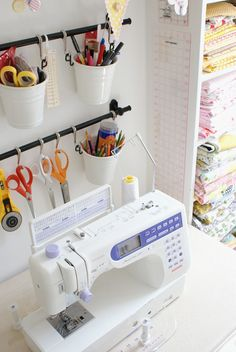 MessyJesse: Craft/Sewing Room Update - there are LOTS of things i like about this room. she mentions by name several ikea products that she used to store things. i love the hanging pots and hooks for scissors & rotary cutters! hanging rulers from nails is a great idea.