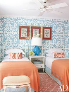 Dubbed the Bali Isle Room, the guest quarters of a Bahamian cottage combine a China Seas wallpaper with citrus hues. The orange cotton throws are from Bamboo-Bamboo, the bed linens are by Matouk, and the rug is by Madeline Weinrib from ABC Carpet & Home.