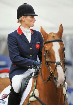 Zara Phillips reacts on her horse Toytown after officially retiring the World Championship Winning horse during the Festival of British Eventing at Gatcombe Park, Gloucestershire