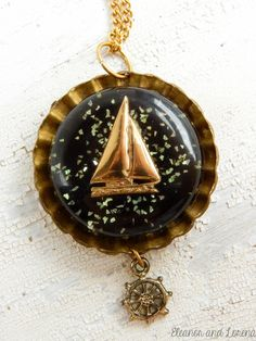 Sailboat necklace / boat necklace / ship wheel necklace / ship helm necklace / brass boat necklace / brass necklace / sailboat cameo by EleanorandLorena on Etsy
