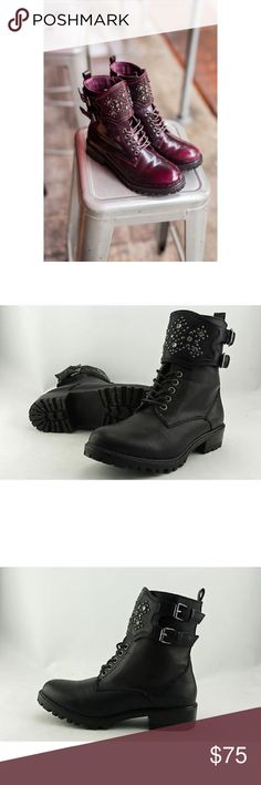 Black Embellished Motto Combat Boot Studded shield design. Vegan leather upper. Silverstone buckles. Easy-on side zipper. Slightly lugged outsole. You're the definition of edgy in These combat boots. A chunky block heel supplies this shoe with knockout style, right down to its sole. Shaft height: 6 in Shaft circumference: 10 in 1-1/2 in. block heel. Black Only. First picture shows same shoe just different color. Anthropologie Shoes Combat & Moto Boots