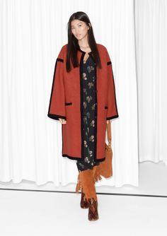 Model wears: size S    Length of coat: 107 cm (size S)