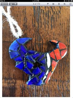 Red, white, and blue Houston Texan ornament, measures 3.5x 2.75 inches.