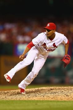 Reliever Carlos Martinez pitches against the Reds in the sixth inning. Cards won the game 6-5 in the 10th inning. 8-18-14
