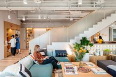 Located at 97 Songren Road, Taipei, adjacent to the famous Taipei 101 Building, WeWork's first community in Taiwan was located in the Xinyi. Modern Staircase, Staircase Design, Under Stairs Nook, Gray Interior, Interior Design, Comfy Sofa, Ergonomic Chair, Room Planning
