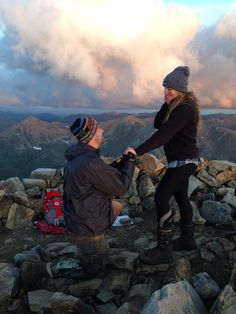 My boyfriend Mike proposed to me after a long hike in the middle of the night to the summit of the tallest mountain in Colorado!!! He proposed at sunrise:) I've dreamed of all these Pinterest proposal pictures for years and he was lucky enough to get us one:)